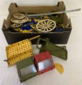 A box of assorted vintage Meccano. To include wheels and plates in varying sizes.