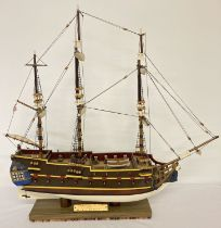 A handmade wooden scale model of a 18th century 32 gun frigate. With detailed masts, sails and body.
