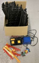 A box of Scalextric track, railings, controller, power unit and a Benetton racing car.