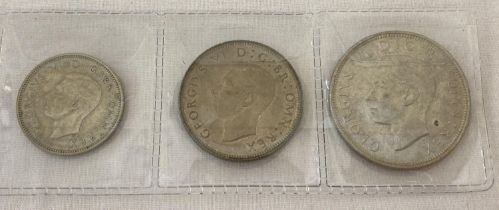 A half silver George VI half crown, two shilling and one shilling coin, all dated 1945. …