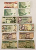 A collection of 12 assorted foreign bank notes. To include: Singapore, South Africa, Bolivia, Jam…