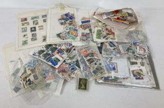 A quantity of assorted British and foreign vintage used stamps. …