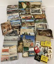 A shoe box of assorted vintage ephemera to include a quantity of assorted postcards, matchboxes a…