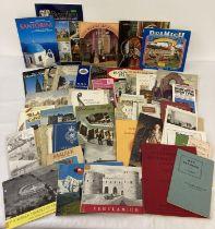 A box of assorted vintage ephemera, mostly souvenir tourist brochures, guide books, maps and prog…