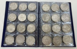 A folder containing 72 assorted white metal coins from around the world. Folder approx. 21cm x 16…