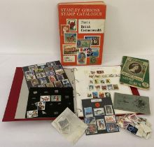 A 1982 edition Stanley Gibbons Stamp Catalogue. Together with a red binder, Solomon Islands stamp…