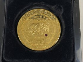 A large 2017 24ct gold layered House Of Windsor Centenary 5 crown coin by The Bradford Exchange. …