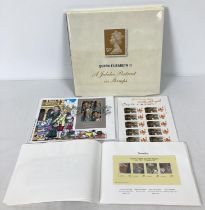 """A copy of """"Queen Elizabeth II A Jubilee Portrait In Stamps"""" together with a small collection of S…"""