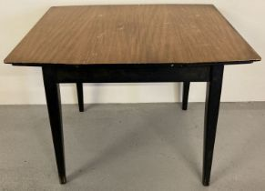 A vintage 1960's teak draw leaf kitchen table with veneered top and with ebonised legs and frame.
