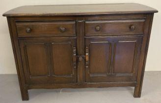 A vintage mid century dark wood Ercol double door sideboard.