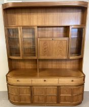 A very large vintage Nathan 2 sectional teak wall unit, #4154 Combination unit.
