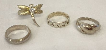4 silver and white metal dress rings.