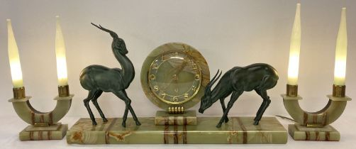 A large Art Deco French marble and onyx mantle clock garniture.