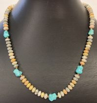 """A 17"""" leopard skin jasper and turquoise beaded necklace with gold tone T bar clasp."""