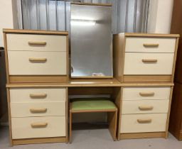 A 1980's Stag light wood & cream dressing table with matching mirror and bedside cabinets.