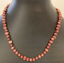 """A 15"""" dyed freshwater pearl necklace with silver tone magnetic barrel clasp."""