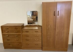 A mid century G Plan 3 piece bedroom suite with wooden hoop handles.