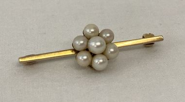 A 9ct gold and pearl flower design bar brooch.