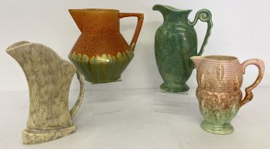 A collection of 4 Art Deco pottery jugs to include Carlton Ware, Crown Derby & Falcon Ware.