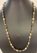 """A 20"""" multicoloured freshwater pearl necklace with gold tone magnetic clasp."""