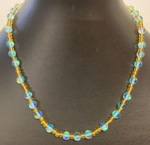 """A 15"""" yellow glass and turquoise Austrian crystal beaded necklace with gold tone magnetic clasp."""