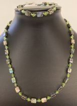 A matching abalone and crystal beaded necklace and bracelet.