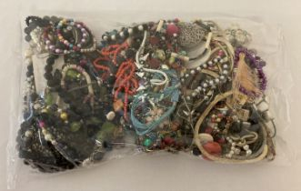 A sealed bag of mixed modern costume jewellery, to include bracelets and necklaces.
