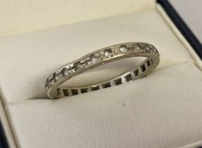 A vintage 14ct white gold full eternity ring set with clear stones.