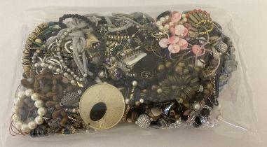 A sealed bag of mixed modern costume jewellery to include statement necklaces and bracelets.