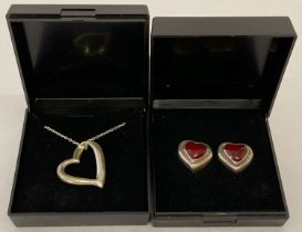 A boxed floating heart white metal pendant on a 925 silver belcher chain.