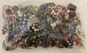 A sealed bag of mixed modern costume jewellery to include bracelets, bangles and necklaces.