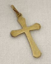 An 8ct gold cross shaped pendant complete with bale.