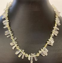 A spikey rock crystal, peridot and citrine necklace with gold tone T bar fixing.