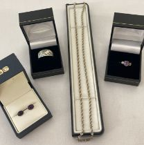 4 items of boxed silver jewellery.