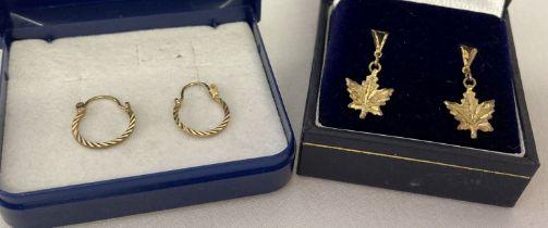 2 boxed pairs of earrings. A pair of Bond Boyd sterling silver maple leaf drop style earrings.