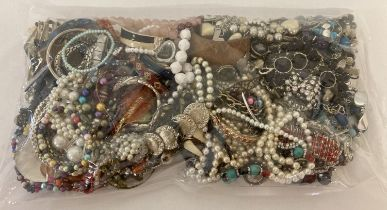 A sealed bag of mixed modern costume jewellery to include bangles, necklaces and bracelets.