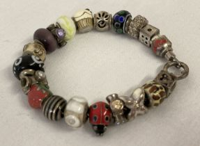 A silver rope design charm bracelet by Truth together with 20 assorted charms.