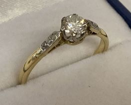 A vintage 18ct gold diamond solitaire dress ring.