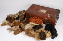 Brown leather suitcase containing a collection of wigs, the case with Cunard White Star line luggage