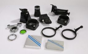 Collection of Hasselblad and Leitz camera accessories, consisting of a boxed Hasselblad Focusing