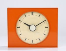 Smiths Sectronic 1960's mantel clock, the white dial with baton markers, housed in an orange plastic