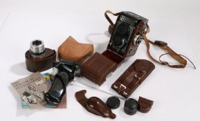 Rolleiflex camera and accessories, the camera a T Model K8 in case with lenses, diffusor, pistol