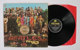 The Beatles - Sgt. Peppers Lonely Hearts Club Band LP ( PMC 7027 ), first pressing with red and