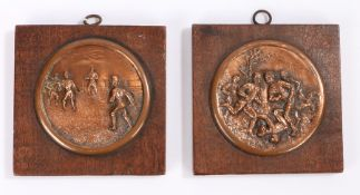 Pair of circular copper sporting plaques, mounted on later wooden back plates, the plaques 8cm