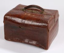 Crocodile skin vanity case, the exterior initialled A.M.J. containing non-contemporary silver