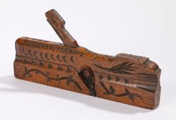 19th Century moulding plane with carved stylised leaf and crescent decoration, 27cm wide