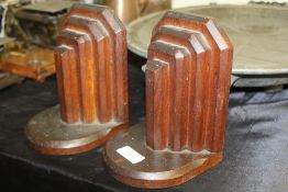 Pair of Art Deco style oak bookends, with stepped chamfered decoration, 17cm high
