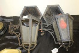 Pair of wall lanterns, of hexagonal tapering form with domed caps and scrolled wall mounts (2)