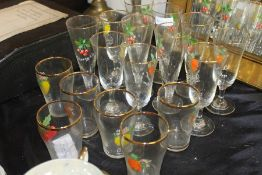 Glasses with fruit decoration, consisting of eleven flutes and six tumblers (qty)