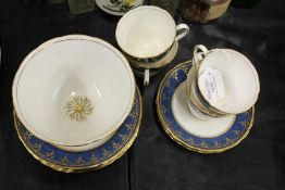 New Chelsea Staffordshire part tea service, the blue mottled ground with gilt scroll decoration,